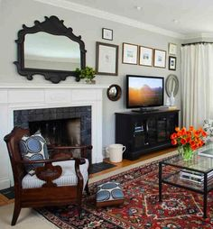 Transitional living room with custom textiles, iron mirror, oriental rug and wall art collection.
