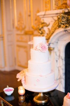 Four Tier White Wedding Cake | photography by http://oneandonlyparisphotography.com/