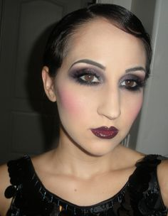 1920's Make up!  Love this!  The eye lashes totally make the look!  Love the plum colors, smokey eye and