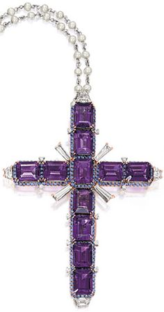 AMETHYST, DIAMOND AND GEM-SET 'CROSS' PENDANT NECKLACE Modelled as a cross, set with eleven emerald-cut amethysts together weighing approximately 23.25 carats, framed by circular-cut sapphires, embellished by variously-shaped diamonds,