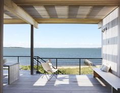 Outdoor Space    On the covered porch outside the living area, Tamarkin can tell time from shadows cast by the slatted cypress sunscreen overhead.