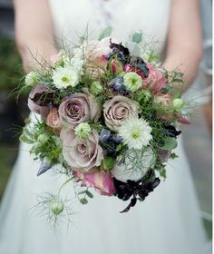 Whimsical and vintage style bouquet for an an outdoor wedding.