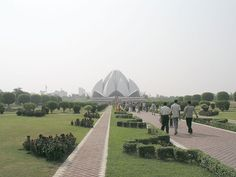 Located Near OYO 9553 Hotel Kings Plaza, The Lotus Temple, located in Delhi, India, is a Bahá'í House of Worship that was dedicated in December New Delhi, Delhi India, Lotus Temple, Concrete Structure, India Travel, India Trip, Historical Monuments, Exterior Lighting, Old City