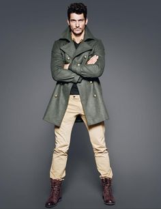 David Gandy - green (double breasted or brass button or peacoat), dark grey shirt, khaki pants, and brown boots