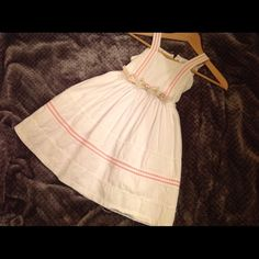 Girls  Fancy White Dress size 4-5 This is a beautiful white dress my daughter used once as a flower girl in Vallarta. It has exquisite detail throughout and a removable broche at the waist size is 4 but she was 5 when she wore it. Could be used for first communion or Easter Dresses Midi