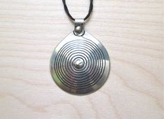 REDUCED Silver tone Moroccan Berber pendant traditional spiral   Etsy Ethnic Jewelry, Leather Cord, Fashion Necklace, Moroccan, Spiral, Necklaces, Traditional, Pendant, Metal