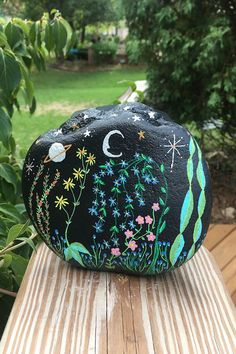 The Midnight Flower Garden rock will make a one of it's kind housewarming gift for that special friend, deserving teacher, gardener who has everything, outdoorsy friend who is hard to buy for, or yourself.