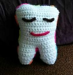 Tooth Fairy Pillow - has a colourful reverse side with pocket - free crochet pattern by Megan Bringold.