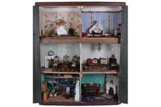 A rare early English dolls house cupboard and contents, circa 1850, the painted natural wood effe