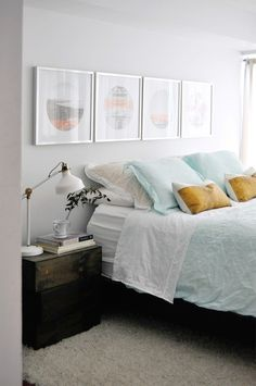 Bedroom with gray walls and soft aqua linen bedding