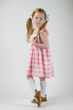Laura ♥ Current turnaround time is 3 weeks, PLUS shipping time  ♥ Pretty pink gingham dress is the perfect summer dress! Any little girl would love to frolic about her day in the Laura dress, with its big bow on the front and little flutter sleeves.  ♥ Bow on the front is sewn onto the dress and not removable  ♥ Please refer to photo #5 for size chart and measurements ♥ Please note ~ due to the handmade nature of items, the pattern placement may differ slightly from the listing photo. ♥ All…
