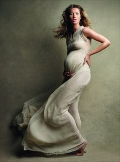Great lighting / Pregnancy portrait #pregnant #photo #photography #ideas.  I really like the idea of a preg ball gown instead of the maxi skirt and tube top.  So elegant