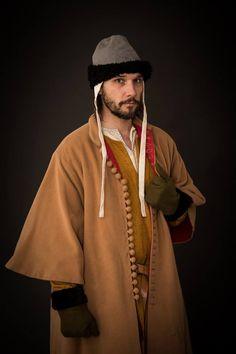 1st half of 14 th century, silk tunic, woolen surcote with red linen, woolen cap trimmed with fur