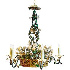 View this item and discover similar for sale at - Elegant tole chandelier with antiqued white metal flowers and antiqued green foliage in a reticulated gilt metal basket. Six antiqued white lilies serve Vintage Lighting, Chandelier Pendant Lights, French Tole, Modern Chandelier, French Lighting, Italian Chandelier, Lights, French Country Baskets, Chandelier
