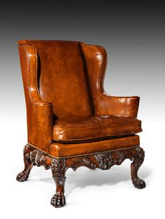 ~ A Handsome Late Victorian Leather Carved Wing Chair, c. 1890 England ~ onlinegalleries.com