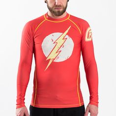 Since his big on-screen debut in DC's Justice League movie, everyone wants a piece of the Scarlet Speedster!  Well, now you can with this officially licensed Fusion Fight Gear Flash Logo BJJ rash guard! It features the signature Flash logo, but made to look like a faded out and distressed T-Shirt. This way you can wear it out to the nightclub, or to the gym. #theflash #rashguard #bjj #dccomics #jiujitsu