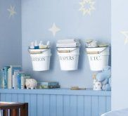 Ignore the spanish website...love  this idea for above the changing table though