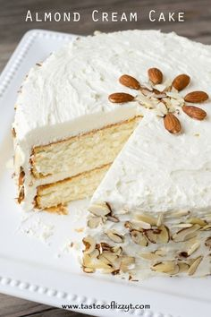 Almond Cream Cake >> by Tastes of Lizzy T's. Light, moist and velvety, this Almond Cream Cake has a homemade cooked, whipped frosting that pairs perfectly with the almond cake. Decorate the cake simply with sliced almonds. Good Cake for holiday Mini Desserts, Just Desserts, Delicious Desserts, Dessert Recipes, Easter Recipes, Frosting Recipes, Light Desserts, Homemade White Cakes, Whipped Frosting