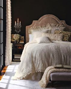 I love this. There is a hint of old world elegance. The LOVE that low stool at the end of the bed.