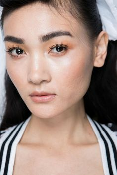 13 Must-See Beauty Trends from Milan Fashion Week Spring 2016 | Peachy eyeshadow at Stella Jean, and dramatic spidery lashes—a trend we've spotted constantly this fashion month. | @StyleCasterBeauty