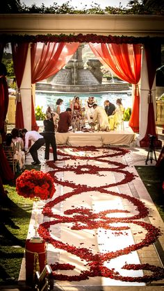 all red roses-red rose petal aisle paired with rose garlands and red drapery for this royal indian wedding. I like the design that has both hearts and a paisley look to it. Wedding Aisles, Aisle Runner Wedding, Aisle Runners, Royal Indian Wedding, Desi Wedding, Bollywood Wedding, Wedding 2015, Indian Weddings, Summer Wedding