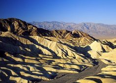 Death Valley is a spectacular below-sea-level basin combines the hottest driest and lowest points in North America. Steady drought and record summer heat make Death Valley a land of extremes but each extreme has a striking contrast. Towering peaks are frosted with winter snow. Rare rainstorms bring vast fields of wildflowers. Lush oases harbor tiny fish and provide refuge for wildlife and humans.