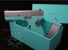 Tiffany Co and Kahr Handgun. I only want it if it comes with a laser pointer.