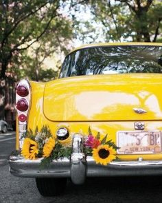 Vintage Taxi with Sunflowers - Wedding Getaway Inspiration - Martha Stewart Weddings