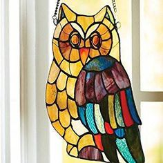 """This cute little owl is quite a """"hoot"""" with his colorful Tiffany-inspired glass detailing. Add this window panel to your home and let beautiful light shine through and bring it to life. Hanging Stained Glass, Faux Stained Glass, Stained Glass Panels, Stained Glass Projects, Stained Glass Patterns, Glass Art Design, Glass Butterfly, Glass Flowers, Window Art"""