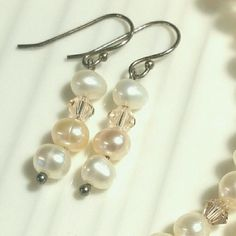 Pearl Earrings Genuine pink and white Freshwater pearl, Swarovski crystals, and sterling silver were combined to create these classic beauties.   I have created several different pieces of pearl jewelry including many earrings and necklaces. Please message if you'd like to know about other options! Jewelry Earrings