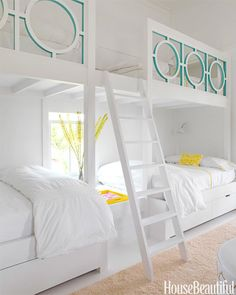 Sally Markham designed a lattice railing for these girls' bunk beds in Sullivan's Island, South Carolina. The touch of Benjamin Moore's Peacock Blue on just the inside of the cut-outs is a genius exercise in restraint. Pin it »