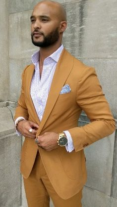 Custom rust cotton suit with lavender check shirt and suede loafers