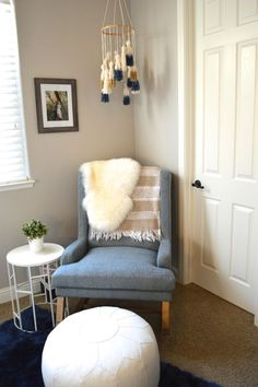 Contemporary Rocking Chair paired with a DIY tassel mobile are perfect in an eclectic nursery