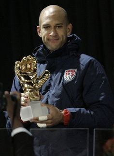 USA's goalkeeper Tim Howard holds up his 'Golden Glove' award following the Confederations Cup