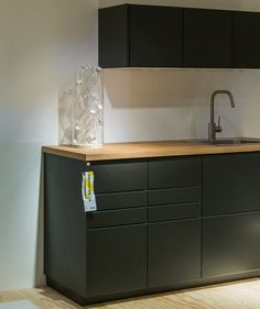 Normally, Ikea's kitchen cabinets are made from man-made wooden planks, but the new line, Kungsbacka, is made from reclaimed wood with a veneer made from recycled plastic bottles.