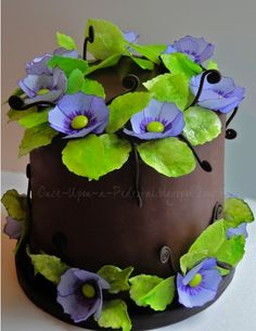 Purple Wafer Paper Flowers - Handpainted flowers with detailed edges, m center. Leaves are also wafer paper. Devils Food with espresso BC and dark chocolate ganache. (I bet Eric and I could make this with practice:-) Wafer Paper Flowers, Wafer Paper Cake, Sugar Flowers, Purple Flowers, Craft Flowers, Fondant Flowers, Cupcakes, Cupcake Cakes, Mini Cakes