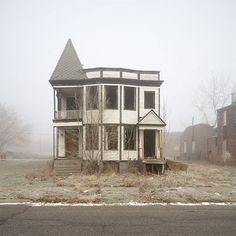 Detroit abandoned house with the fog. Who might have lived here long ago when the city was thriving?
