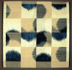 Various blocks of ikat in indigo blue, tan and off-white. This is a panel from United States.