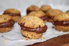 Dark chocolate & hazelnut cookies with orange ganache filling.