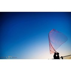 Look at that Veil!!! Thanks to Aimee & Adrian for putting up with the wind and cold for this frame taken at the Brooklyn Promenade. #wedding #silhouette #brooklyncouple #flyingveil by joshua_dwain_photography