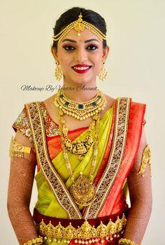 Our bride Sharanya looks ravishing for her muhurtam. Makeup and hairstyle by Vejetha for Swank Studio. Red lips. Bridal jewelry. Bridal hair. Silk sari. Bridal Saree Blouse Design. Indian Bridal Makeup. Indian Bride. Gold Jewellery. Statement Blouse. Tamil bride. Telugu bride. Kannada bride. Hindu bride. Malayalee bride. Find us at https://www.facebook.com/SwankStudioBangalore