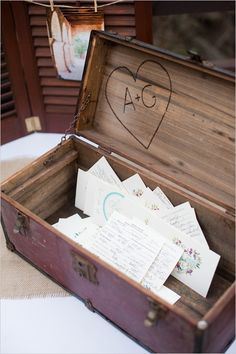 Ashley and Geoffrey placed cards for guests to write well wishes on each table. They used our free printable Floral Heart Monogram and our Circle Love Custom Monogram. They were stacked on each table and wrapped in twine, and guest placed them in this customized wood box.