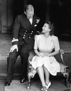 Princess Elizabeth and Lieutenant Philip Mountbatten announcing their engagement at Buckin...