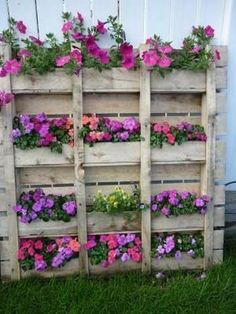 Pallet flower box...stain, plant and nail to bottom of house where it's unfinished
