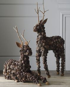 """""""Alpine"""" Pine Cone Deer at Horchow. These two woodland guests are ready to add to the festivities at holiday gatherings. Display them au naturale or bedeck them in ribbons, greenery, and ornaments to create a look that is uniquely yours.  Handcrafted of pine cones, twigs, and wood on a wire frame."""