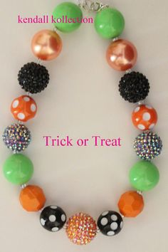 Trick or Treat Necklace is a must have for Halloween!    Necklace is 16 inches in length and comes with a 3 inch extender.    This necklace,