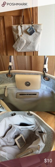 """Jones New York handbag Beige handbag with wristlet and mirror accessories. 4 inside pockets and snap closure. 4 1/4"""" x 9 1/4"""" hard platform bottom with 4 studs. Small yellow stain on inside of strap (see pic#4). 12"""" long, 15"""" wide across the top, 4"""" deep across bottom and 9"""" drop from shoulder. Easy to carry on arm or shoulder. Jones New York Bags Shoulder Bags"""