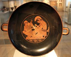 Achilles Binding Patroclus' Wounds Artist: Sosias Painter Date & Location: 500 BCE in Greece Media: Painted Pottery (Kylix Vase) Where can I see this artwork? Achilles And Patroclus, Greek Warrior, Greek Pottery, Trojan War, Queer Art, Pottery Painting, Museum Of Fine Arts, Art History, Decorative Plates