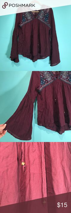 Burgundy trumpet sleeve top New. Tags removed but never worn. Tops Blouses