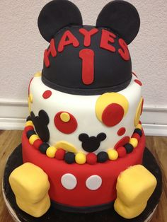 """Elizabeth and Wesley """"s lil Hayes' first birthday! Three tier Mickey--all edible with Rice Krispie shoes."""